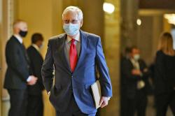 Senate Majority Leader Mitch McConnell of Ky., wears a face mask to protect against the spread of the new coronavirus as he walks to the Senate chamber after meeting with Vice President Mike Pence and Treasury Secretary Steve Mnuchin on Capitol Hill in Washington, Tuesday, May 19, 2020