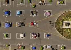 Rectangles designed to help prevent the spread of the coronavirus by encouraging social distancing line a city-sanctioned homeless encampment at San Francisco's Civic Center on Thursday, May 21, 2020