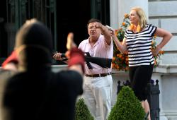 Armed homeowners standing in front their house along Portland Place confront protesters marching to St. Louis Mayor Lyda Krewson's house Sunday, June 28, 2020, in the Central West End of St. Louis.