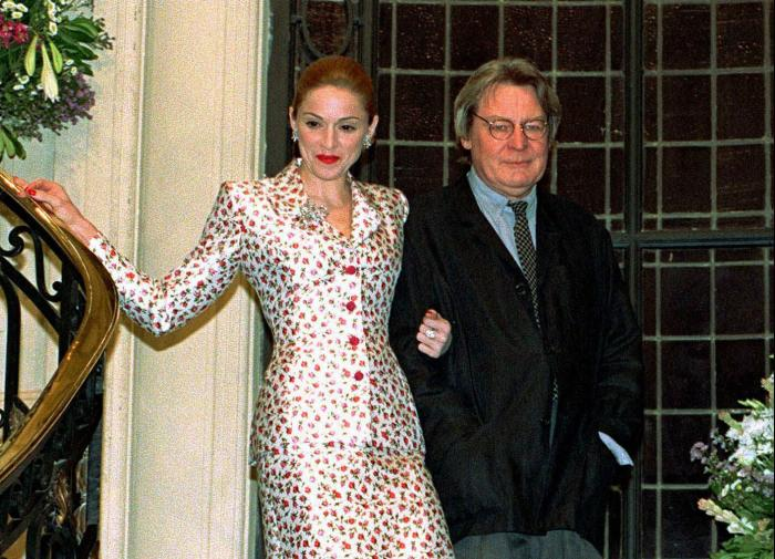 """Actress-singer Madonna arrives for a news conference about the musical film """"Evita"""" with British director Alan Parker in Buenos Aires on Feb.6, 1996."""