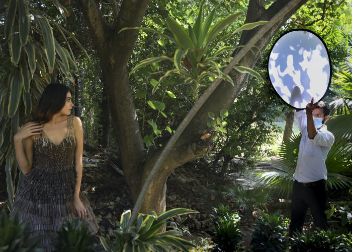 A model poses during a photo shoot for the Lotus Make-up India Fashion Week, at the farmhouse of a designer in New Delhi, India.