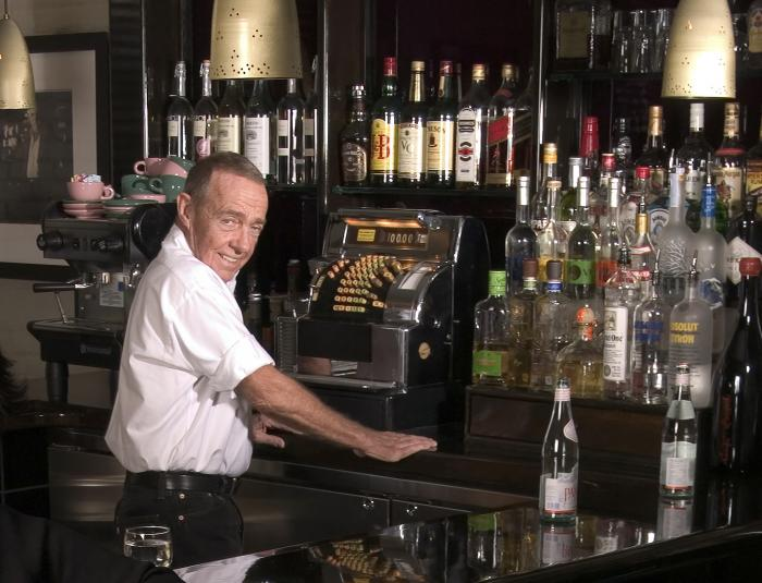 Joe Allen, proprietor of Joe Allen's restaurant poses behind the bar in New York on Nov. 10, 2005.