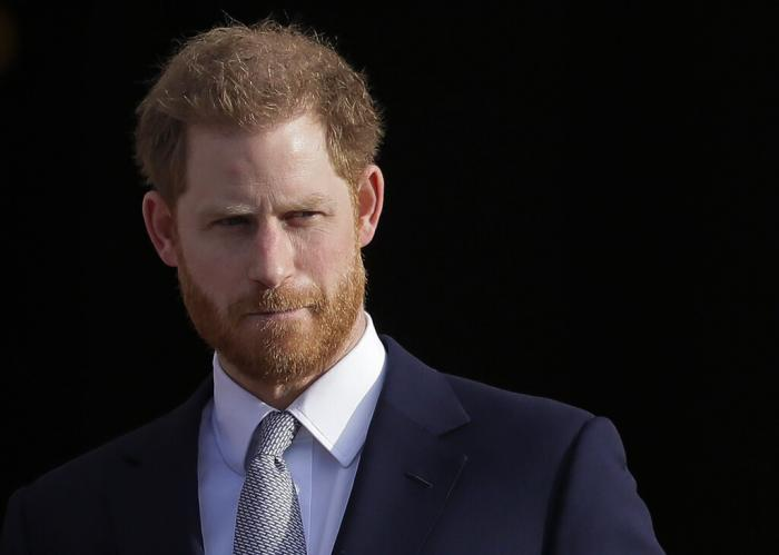 Britain's Prince Harry arrives in the gardens of Buckingham Palace in London.