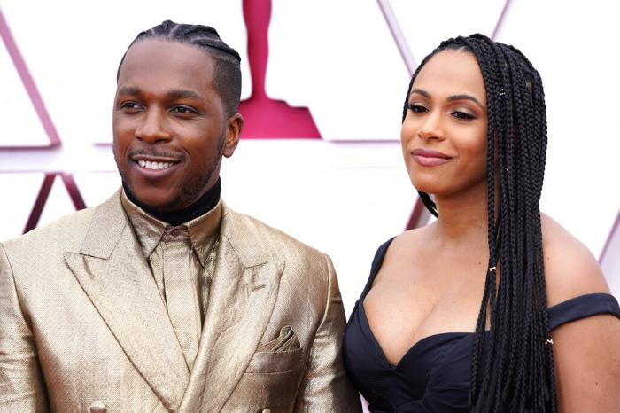 Leslie Odom Jr., left, and Nicolette Robinson arrive at the Oscars on Sunday, April 25, 2021, at Union Station in Los Angeles.