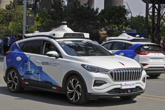 Baidu Apollo Robotaxis move on a street at the Shougang Park in Beijing, Sunday, May 2, 2021