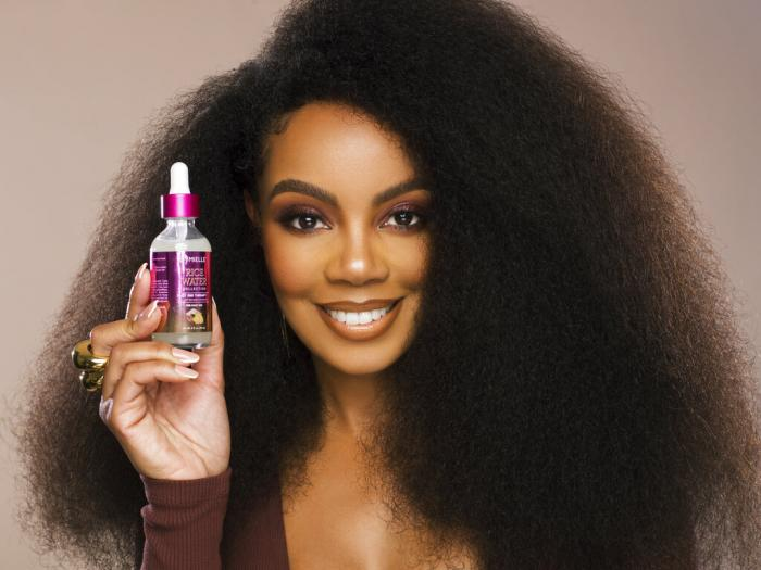 Monique Rodriguez poses with one of her company's hair products.