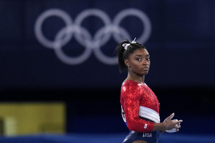 File-This July 27, 2021, file photo shows Simone Biles, of the United States, waiting to perform on the vault during the artistic gymnastics women's final at the 2020 Summer Olympics, Tuesday, July 27, 2021, in Tokyo.
