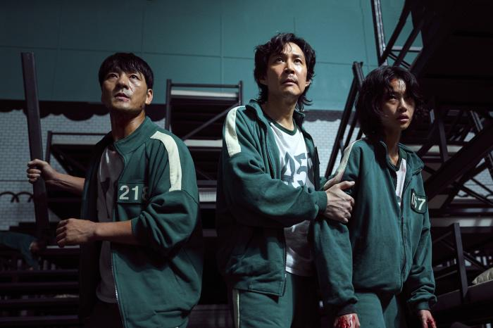 """From left, Park Hae-soo, Lee Jung-jae and Jung Ho-yeon in a scene from """"Squid Game."""""""